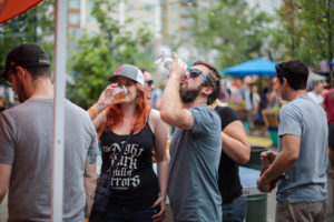 chugging a beer at great divide block party